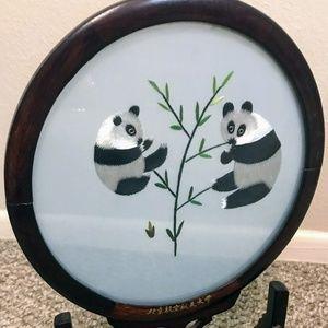 Panda embroidery in circular frame